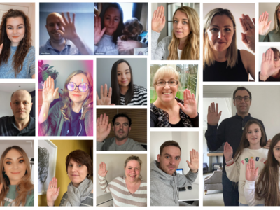 Collage of our staff holding their hands up to support IWD 2021